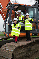 Isabella Chapman 10, of John Hunt Primary school, with Nicole Gardner, 16 and Ryan Parrett 11, both of Newark Academy take to the excavator to turn the first sod at the site of the new Newark Academy being built by Kier Construction