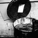 Waste ink collects in a barrel. The old press of the Statesman Journal is about to go dark. Newspapers will no longer be printed on-site in Salem.