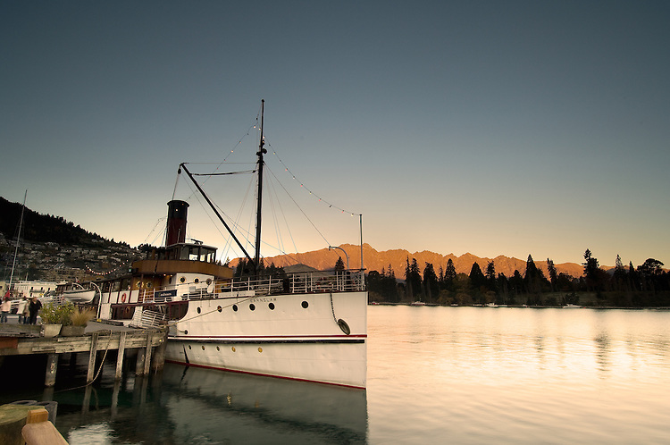 The Earnslaw steamship docked at Steamer Wharf. The Remarkables in the background, Queenstown, New Zealand