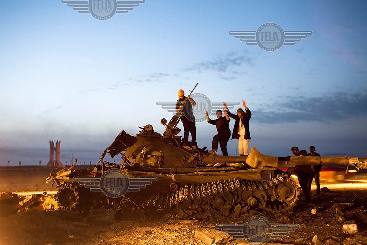 Rebels celebrate on a wreck of a tank that was destroyed a few days earlier by the coalition air strike. On 17 February 2011 Libya saw the beginnings of a revolution against the 41 year regime of Col Muammar Gaddafi.