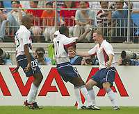 DaMarcus Beasely and  Eddie Pope celebrate with John O'Brien after scoring a goal during the USA victory 3-2 over Portugal at the World Cup 2002 in Korea, June 5, 2002.