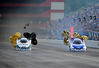 Jun. 19, 2011; Bristol, TN, USA: NHRA funny car driver Mike Neff (left) races alongside teammate Robert Hight during eliminations at the Thunder Valley Nationals at Bristol Dragway. Mandatory Credit: Mark J. Rebilas-