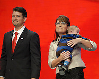 Alaska Governor and Republican Vice President nominee Sarah Palin with her husband todd and son Trig Palin at the 2008 Republican National Convention at the Excel Center in St. Paul, Minnesota.