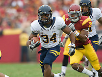 Shane Vereen of California rushes the ball away from USC defenders during the game at LA Memorial Coliseum in Los Angeles, California.  USC defeated California, 48-14.