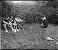 BNPS.co.uk (01202 558833)<br /> Pic: Bonhams/BNPS<br /> <br /> Jackie prepares to take a photo of Jack and some friends.<br /> <br /> Fascinating photographs of the Kennedys during their first year of marriage have emerged for auction.<br /> <br /> The intimate snaps of the future US president and his wife Jackie were taken by renowned photographer Orlando Suero who spent five days with the couple at their Georgetown home in May 1954.<br /> <br /> At the time, Kennedy was a young senator from Massachusetts establishing himself as one to watch on the US political scene.<br /> <br /> The collection's owner, Max Lowenherz, donated the bulk of the photographs and negatives to the Peabody Institute of Johns Hopkins University in Maryland, USA.<br /> <br /> He has now decided to put 31 of them up for auction and they are tipped to sell for &pound;4,900 ($6,000).