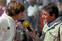LONG BEACH, CA - MARCH 15: Eddie Cheever of the United States and driver of the Tyrrell 010 3/Ford Cosworth DFV is interviewed in the pit lane before practice for the United States Grand Prix West FIA Formula One World Championship race on the temporary Long Beach Street Circuit in Long Beach, California, on March 15, 1981.