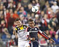Columbus Crew midfielder Bernardo Anor (7) and New England Revolution midfielder Juan Agudelo (10) battle for head ball.  In a Major League Soccer (MLS) match, the New England Revolution (blue) defeated Columbus Crew (white), 3-2, at Gillette Stadium on October 19, 2013.