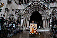 Kaya Mar, Painter and political caricaturist - 2012 <br /> <br /> London, 25/04/2012. Royal Courts of Justice. People gathered outside the Royal Courts of Justice to demonstrate against Rupert and James Murdoch. In the meanwhile inside the building, Rupert Murdoch was again facing questioning at the Leveson Inquiry.