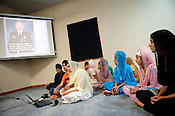 The pre-vigil gathering at Sikh Gurudwara of North Carolina in Durham included pictures and bios posted about each of the victims of the Oak Creek shooting on Wednesday August 8th 2012.