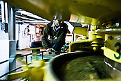 Factory manager, Sanjay Mukherjee keeps a keen eye on the process of rolling of tea leaves at Makaibari Tea Estate factory, Kurseong in Darjeeling, India.