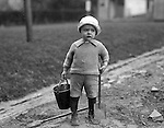 Wilkinsburg PA:  Brady Jr is dressed and has his tools to help dad clean up outside the house in Wilkinsburg - 1922.