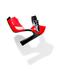 Trendy red with black high heel platform shoe falling through the air isolated on white background