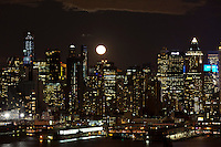 The moon rise along the skyline of Middle Manhattan while it is seen from Weehawken in New Jersey March 27, 2013. Photo by Eduardo Munoz Alvarez / VIEWpress.