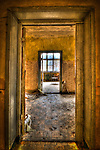 Interior of old tanks barracks somewhere near Berlin looking through doorways to window