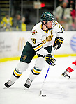 9 January 2011: University of Vermont Catamount defenseman Kevan Miller, a Senior from Los Angeles, CA, in action against the Boston University Terriers at Gutterson Fieldhouse in Burlington, Vermont. The Catamounts fell to the Terriers 4-2 in Hockey East play. Mandatory Credit: Ed Wolfstein Photo
