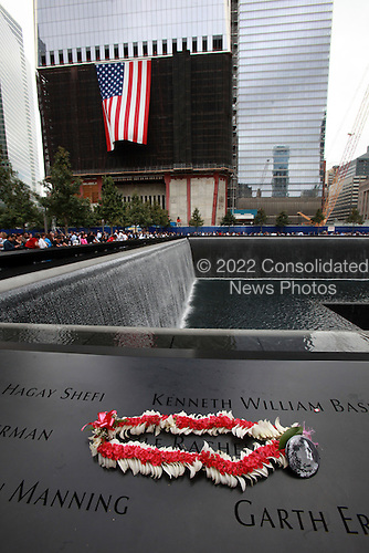 On the 10th anniversary of the September 11th attacks, a memento was left at the North Memorial Pool at opening day of the September 11th Memorial at the World Trade Center site in New York, New York on Sunday, September 11, 2011. .Credit: Jefferson Siegel / Pool via CNP