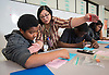 Lynn McGowan works with her eighth grade math students at Forest Brook Middle School, April 21, 2014.