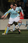 15.01.2013. Torquay, England. Exeter's Scott Bennett shields the ball from Ryan Jarvis during the League Two game between Torquay United and Exeter City from Plainmoor.