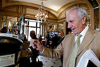 Claudio Calvino, from Naples, buys a caffe sospeso at Caffe Gambrinus, Naples, Italy