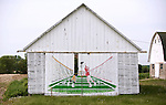A collection of Barns that still can be seen while traveling the countryside in  the beautiful State of Wisconsin.<br /> Packers and Badgers painted on Shed on Hoepker Rd. north of Madison in Dane County.