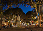 "Early evening view down the Cours Mirabeau, Aix-en-Provence, France, during the ""blue hour,"" including the fountain and statue of King Rene"