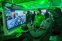 Football fans participate at the Microsoft XBoxone tent on opening day of Super Bowl Boulevard in Midtown Manhattan in New York on Wednesday, January 29, 2014. Despite the game being held in New Jersey on February 2 sports fans are expected to pack New York to take part in the multitude of activities planned around the game including the 13 block stretch of Broadway, running from 34th street through 47th street that will host Super Bowl Blvd. from January 29 to February 1. (© Richard B. Levine)