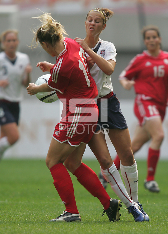 Nov 4, 2006: Seoul, South Korea:  USWNT midfielder (11) Carli Lloyd collides with Canadian forward (10) Amy Vermeulen while playing in the Peace Queen Cup final at Seoul World Cup Stadium. The United States defeated Canada, 1-0.