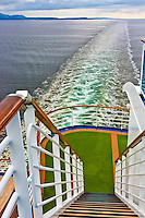A view down the stairs at the stern of a cruise ship looking into the North Sea wake.