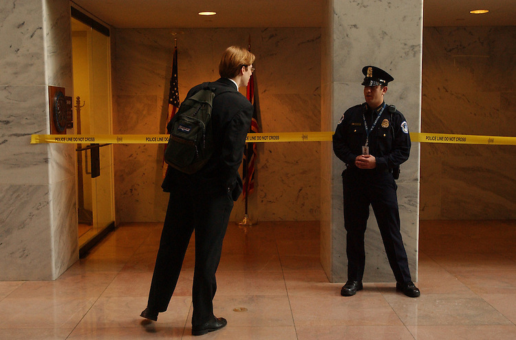 guard101601 -- A Capitol Police Officer stands guard at the office of Sen. Craig Thomas, R-Wyo., in Hart Building.  The office, amoung others, was closed due to an anthrax scare.