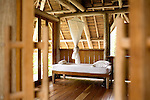 Some of Nikoi's two-story beach villas features an additional room with twin beds and a balcony. The rooms and bathrooms are connected by wooden walkways and covered by alang-alang grass roofs. The private island resort is owned by a group expatriates from Singapore and the United States.