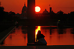 People -- and ducks -- watch the last sunrise of Summer 2012.