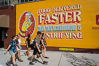 An advertisement for the Seamless food delivery service in the Bushwick neighborhood of Brooklyn in New York on Sunday, September 11, 2016 pokes fun at the gentrification of the area. The neighborhood has undergone gentrification changing from a rough and tumble mix of Hispanic and industrial to a haven for hipsters, forcing many of the long-time residents out because of rising rents. (©Richard B. Levine)