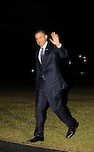 United States President Barack Obama waves to the photographers as he arrives on the South Lawn of the White House in Washington, D.C. after a three day West coast trip, early Saturday morning, February 18, 2012, in Washington, DC.  .Credit: Leslie E. Kossoff / Pool via CNP