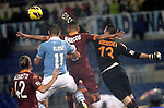 Calcio, Serie A: Lazio vs Roma. Roma, stadio Olimpico, 11 novembre 2012..AS Roma goalkeeper Mauro Goicoechea, of Uruguay, saves the ball past teammates Federico Balzaretti, left, and Marquinhos, second from right, and Lazio forward Miroslav Klose, of Germany, during the Italian Serie A football match between Lazio and AS Roma, at Rome's Olympic stadium, 11 November 2012..UPDATE IMAGES PRESS/Riccardo De Luca