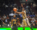 "Ole Miss guard Zach Graham (32) steals the ball from Murray State guard Isacc Miles at the C.M. ""Tad"" Smith Coliseum in Oxford, Miss. on Wednesday, November 17, 2010."