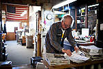 Newt Wallace, 93, prepares Winters Express newspapers for mail delivery, February 6, 2013 in Winters, California. Wallace is believed to be the world's oldest paper delivery boy.