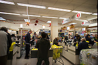"Customers endure long lines because of Hurricane Sandy in a Gristede's supermarket in the Chelsea neighborhood of New York on Sunday, October 28, 2012. In advance of the arrival of Hurricane Sandy New York will down the subways at 7 PM on Sunday and evacuate low lying ""Zone A"" areas including Battery Park City. In addition the schools will be closed on Monday. (© Richard B. Levine)"