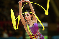 """Anna Gurbanova competing for Azerbaijan waves with ribbon at 2007 World Cup Kiev, """"Deriugina Cup"""" in Kiev, Ukraine on March 17, 2007."""