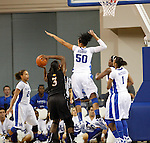 UK center Azia Bishop attempts to block a shot during the first half of the UK Women's basketball game against Southern Miss on 11/19/11 in Lexington, KY. Photo by Quianna Lige | Staff