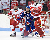 Sean Escobedo (BU - 21), Josh Holmstrom (UML - 12), Matt O'Connor (BU - 29) - The visiting University of Massachusetts Lowell River Hawks defeated the Boston University Terriers 3-0 on Friday, February 22, 2013, at Agganis Arena in Boston, Massachusetts.