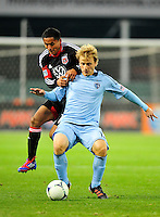 United's Andy Najar goes after the ball against Sporting KC's Seth Sinovic. Sporting Kansas City defeated D.C. United 1-0 during an MLS home opener at the RFK Stadium in Washington, D.C. on Saturday, March 10, 2012. Alan P. Santos/DC Sports Box