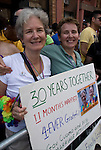 "Lesbian couple holding sign ""30 Years Together  11 months Married 4-Ever Grateful Gov. Cuomo"" at the Pride Parade in New York City."