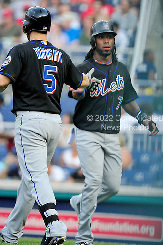 New York Mets third baseman David Wright (5), left, congratulates shortstop Jose Reyes (7), right, after Reyes scored the Mets' first run in the first inning against the Washington Nationals at Nationals Park in Washington, D.C. on Friday, July 29, 2011..Credit: Ron Sachs / CNP.(RESTRICTION: NO New York or New Jersey Newspapers or newspapers within a 75 mile radius of New York City)