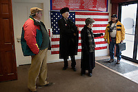 Local members of the Republican party wait to greet former Speaker of the House Newt Gingrich after a radio interview in the Northern Grafton Republicans office in Littleton, New Hampshire.  Gingrich is seeking the 2012 Republican nomination for president.