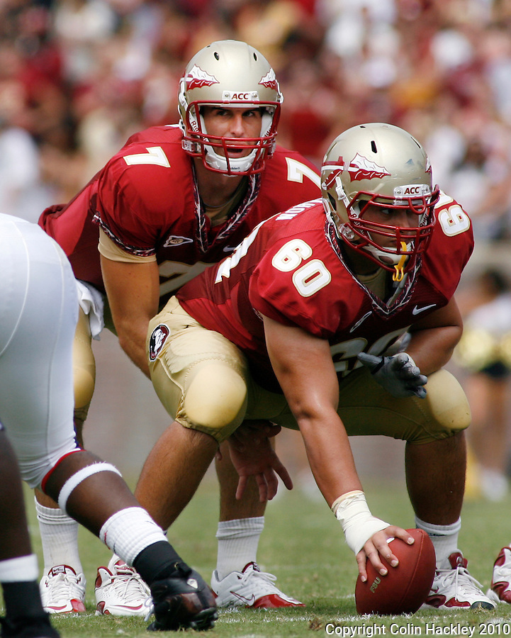 TALLAHASSEE, FL 9/4/10-FSU-SAMFORD FB10 CH-Florida State's Christian Ponder calls the signals as Ryan McMahon readies the snap against Samford during first half action Saturday at Doak Campbell Stadium in Tallahassee. The Seminoles beat the Bulldogs 59-6 to give Head Coach Jimbo Fisher his first victory..COLIN HACKLEY PHOTO