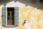 A window with turqoise shudders in Bellagio on Lake Como, Italy.