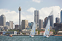 Sailing on the harbor with views of the city, Sydney, Australia.