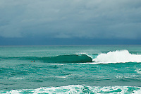 Haleiwa Hawaii, (Thursday December 8, 2010) .Sunset Beach.  A 8'-10' foot north swell with heavy overcast skies, rain showers and Kona winds were the conditions for today's sessions on the North Shore.  Photo: joliphotos.com
