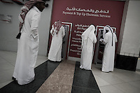 Qatar - Doha -  City Center Mall. Qataris withdrawing money at ATM machine
