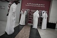Qatar - Doha -  City Center Mall. Qataris withdrawing money at ATM machine